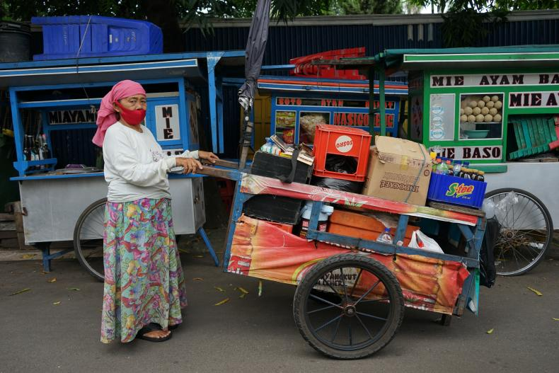 Sumarni, 67, is a soft drink peddler in Central Jakarta, Indonesia.