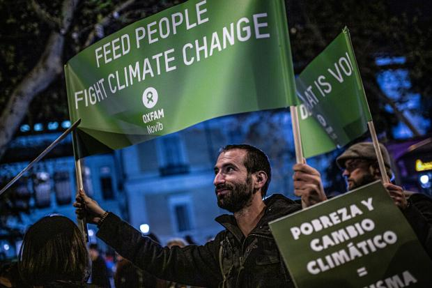 In 2019 we stood up and marched with you to call for fast effective climate action now. Photo credit: Pablo Tosco/Oxfam