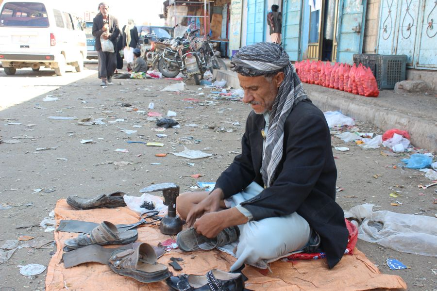 Ahmed works as a cobbler in the market. On good days, he manages to make 500 Yemeni Riyals ($2) a day.